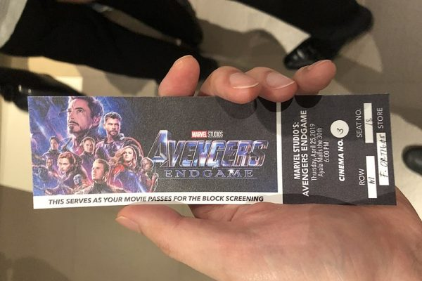 A-person-holding-an-Avengers-Endgame-ticket (1)